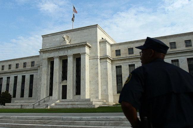 Российская Федерация освободилась еще оттрети ценных бумаг США